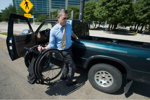 Steve Griffin / The Salt Lake Tribune  Jeff Griffin, of the Wheelin Jazz and Mormon seminary instructor at Murray High School, supports himself as he flips his wheel chair into the back of his truck after visiting Vivint Smart Home Arena in Salt Lake City Monday August 1, 2016.