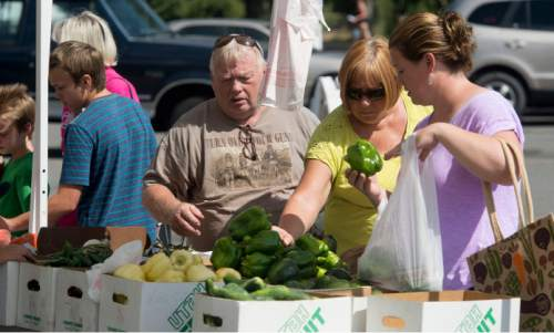 Steve Griffin / The Salt Lake Tribune  People load up bags with fresh produce as the Farmers Market in Murray Park opened for its 35th season in Murray Friday July 29, 2016, making it Utah's oldest farmers market.  All but 14 of the 70 vendors grow their own produce.