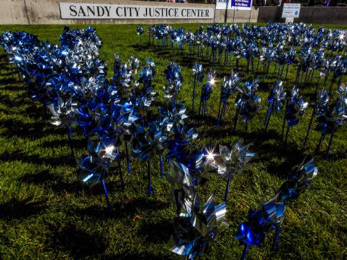 Trent Nelson  |   Tribune file photo 401 pinwheels spin in the lawn of the Sandy City Justice Center last October in recognition of 401 child victims of domestic violence during a Domestic Violence Month ceremony.