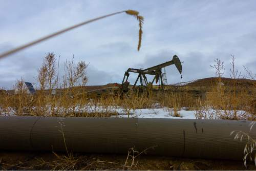 Trent Nelson  |  The Salt Lake Tribune Oil wells along the Nine Mile Canyon National Backcountry Byway in Duchesne County, Tuesday January 19, 2016.