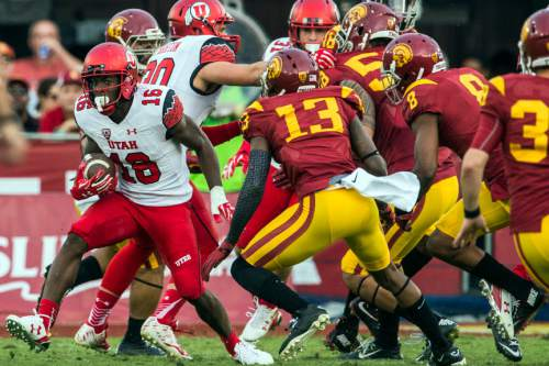 Chris Detrick  |  The Salt Lake Tribune Utah Utes defensive back Cory Butler-Byrd (16) runs the ball past USC Trojans cornerback Kevon Seymour (13)  during the game at the Los Angeles Memorial Coliseum Saturday October 24, 2015.