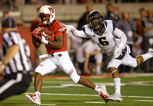 Utah's Cory Butler-Byrd (16) carries a touchdown pass as California cornerback Darius White (6) defends in the first half during an NCAA college football game Saturday, Oct. 10, 2015, in Salt Lake City. (AP Photo/Rick Bowmer)