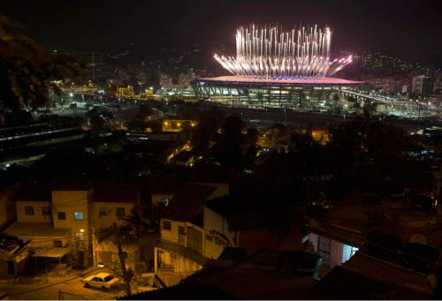 The Mangueira slum is backdropped by fireworks exploding above the Maracana stadium during the opening ceremony of the Rio's 2016 Summer Olympics in Rio de Janeiro in Rio de Janeiro, Brazil, Friday, Aug. 5, 2016. (AP Photo/Leo Correa)