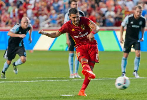 Michael Mangum     Special to the Tribune  Real Salt Lake midfielder Javier Morales (11) takes a penalty kick as Chicago Fire players rush in during their MLS match at Rio Tinto Stadium in Sandy, Utah on Saturday, August 6th, 2016. Morales scored on the kick and Real Salt Lake led 2-0 at the half.