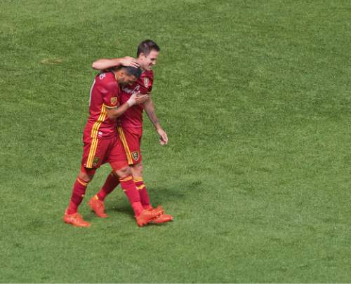 Michael Mangum     Special to the Tribune  Real Salt Lake forward Juan Manuel Martinez (7) congratulates midfielder Javier Morales (11) after Morales scored the second of his two goals during their MLS match against the Chicago Fire at Rio Tinto Stadium in Sandy, Utah on Saturday, August 6th, 2016.
