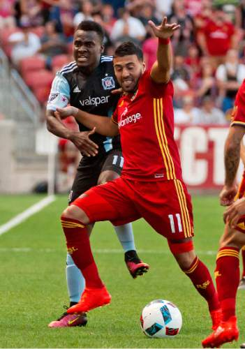 Michael Mangum     Special to the Tribune  Real Salt Lake midfielder Javier Morales (11) and Chicago Fire defender Brandon Vincent (3) battle for possession during their MLS match at Rio Tinto Stadium in Sandy, Utah on Saturday, August 6th, 2016.