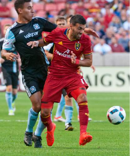 Michael Mangum     Special to the Tribune  Real Salt Lake midfielder Javier Morales (11) shields the ball from Chicago Fire defender Brandon Vincent (3) during their MLS match at Rio Tinto Stadium in Sandy, Utah on Saturday, August 6th, 2016.