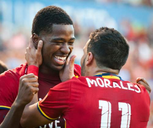 Michael Mangum     Special to the Tribune  Real Salt Lake midfielder Javier Morales (11) congratulates forward Olmes Garcia (80) on his first-half goal during their MLS match against the Chicago Fire at Rio Tinto Stadium in Sandy, Utah on Saturday, August 6th, 2016.