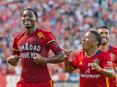 Michael Mangum     Special to the Tribune  Real Salt Lake forward Olmes Garcia (80) celebrates his first-half goal with teammates Joao Plata, center, and Javier Morales, right, during their MLS match against the Chicago Fire at Rio Tinto Stadium in Sandy, Utah on Saturday, August 6th, 2016.