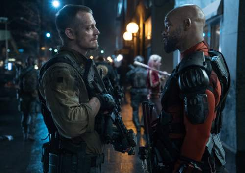 """This image released by Warner Bros. Pictures shows, Joel Kinnaman, left, and Will Smith in a scene from """"Suicide Squad."""" (Clay Enos/Warner Bros. Pictures via AP)"""