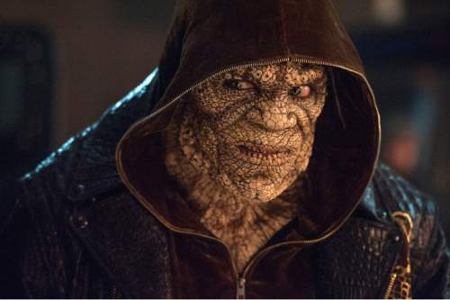 """This image released by Warner Bros. Pictures shows  Adewale Akinnuoye-Agbaje as Killer Croc in a scene from """"Suicide Squad."""" (Clay Enos/Warner Bros. Pictures via AP)"""