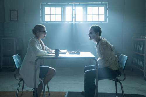 """This image released by Warner Bros. Pictures shows Margot Robbie, left, and Jared Leto in a scene from, """"Suicide Squad."""" (Clay Enos/Warner Bros. Pictures via AP)"""