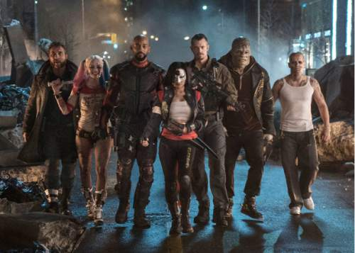 """This image released by Warner Bros. Pictures shows, from left, Jai Courtney as Boomerang, Margot Robbie as Harley Quinn, Will Smith as Deadshot, Karen Fukuhara as Katana, Joel Kinnaman as Rick Flag, Adewale Akinnuoye-Agbaje as Killer Croc and Jay Hernandez as Diablo, in a scene from """"Suicide Squad."""" (Clay Enos/Warner Bros. Pictures via AP)"""