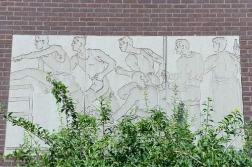 Al Hartmann  |  The Salt Lake Tribune  Athletic mural on the gymnasium at the boarded up Granite High School at 3300 S. 500 E. in South Salt Lake Tuesday July 26.   A prominent developer's deal to buy the old property has been extended and a new development plan is in the works. Garbett Homes and Wasatch Property's previous plan included 78 homes and a retail center anchored by a neighborhood Wal-Mart grocery store and would have put $10.6 million in Granite School District's coffers.