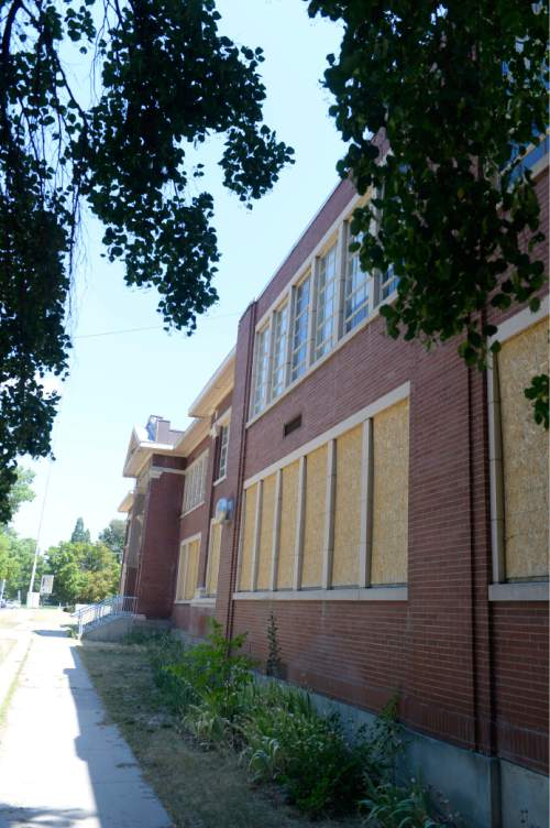 Al Hartmann  |  The Salt Lake Tribune  The old Granite High School at 3300 S. 500 E. in South Salt Lake remains boarded up Tuesday July 26.   A prominent developer's deal to buy the old property has been extended and a new development plan is in the works. Garbett Homes and Wasatch Property's previous plan included 78 homes and a retail center anchored by a neighborhood Wal-Mart grocery store and would have put $10.6 million in Granite School District's coffers.