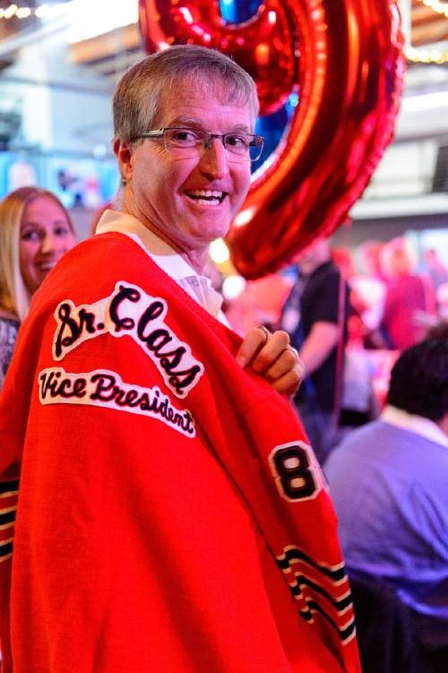 Trent Nelson  |  The Salt Lake Tribune Clint Searle, happy that he can still fit into his jacket from 1988, at the Granite High School reunion in Salt Lake City, Saturday August 6, 2016. This was an unusual high school reunion -- for all alumni of all graduating classes for the school that was open from 1906 to 2009.
