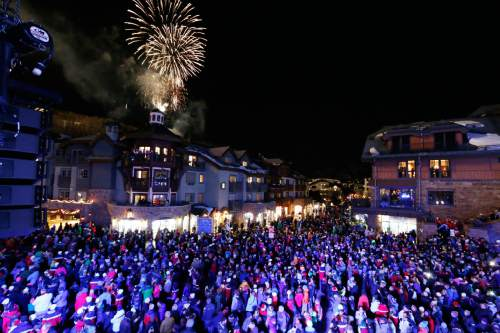 FILE - In this Feb. 2, 2015, file photo, fireworks explode during the opening ceremony for the FIS Alpine World Ski Championships, in Vail, Colo. Vail Resorts, which is the largest resort operator in North America, is buying the continent's biggest ski area, Canada's Whistler, the site of the 2010 Winter Olympics. Vail Resorts Inc. announced Monday, Aug. 8, 2016, that it was purchasing Whistler Blackcomb Holdings Inc., the Canadian ski resort company, for $1.06 billion, adding to its aggressive expansion. (AP Photo/Brennan Linsley, File)