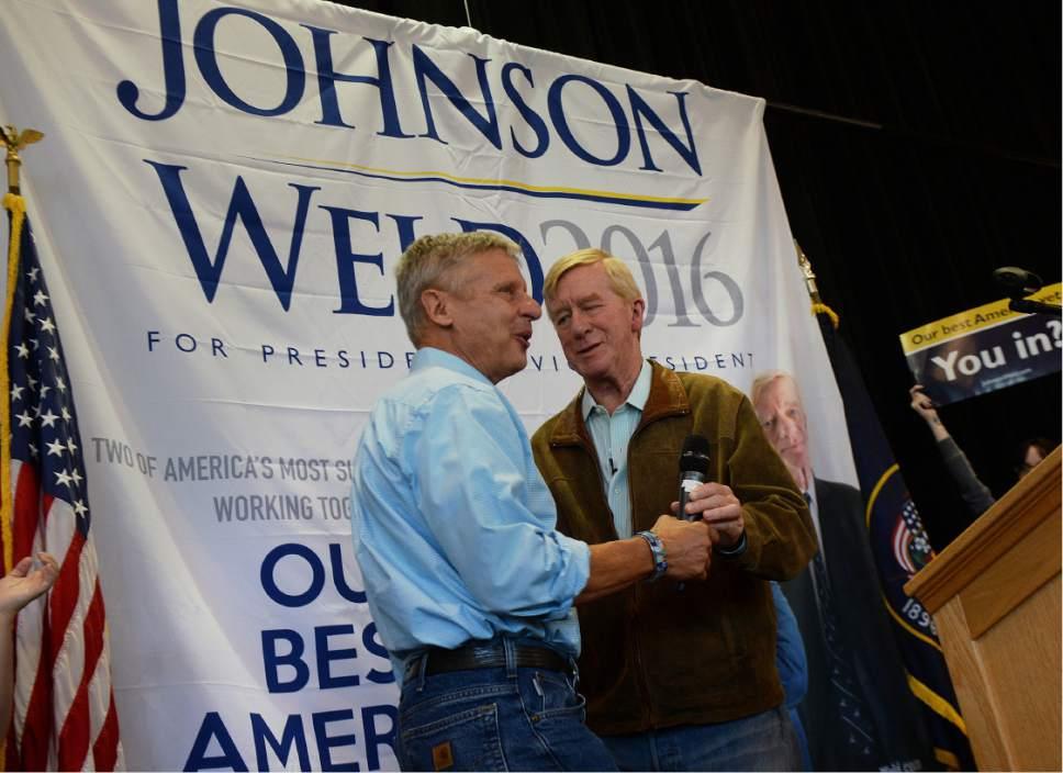 Scott Sommerdorf   |  The Salt Lake Tribune    Gary Johnson, Libertarian candidate for President, left, takes the mic from his running mate William Weld at the University of Utah Student Union, Saturday, August 6, 2016.