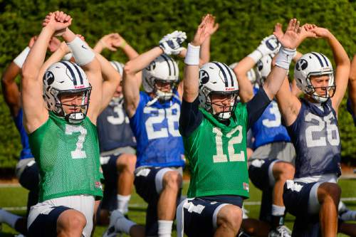 Trent Nelson  |  The Salt Lake Tribune BYU quarterbacks Taysom Hill (7) and Tanner Mangum (12) at the first BYU fall camp practice under new coach Kalani Sitake, Friday August 5, 2016 in Provo.