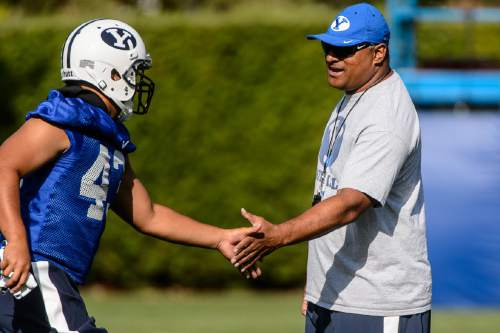 Trent Nelson  |  The Salt Lake Tribune New coach Kalani Sitake oversees his first BYU fall camp practice, Friday August 5, 2016 in Provo.
