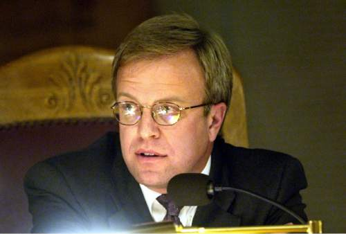 |  Tribune File Photo  Eric Jergensen of the Salt Lake City Council listens to comments Tuesday October 14, 2003, regarding Nordstrom's potential move to Gateway Mall were discussed.