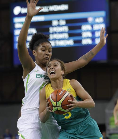 Australia guard Leilani Mitchell, right, runs into Brazil guard Taina Paixao during the first half of a women's basketball game at the Youth Center at the 2016 Summer Olympics in Rio de Janeiro, Brazil, Saturday, Aug. 6, 2016. (AP Photo/Carlos Osorio)