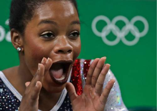 United States' Gabrielle Douglas cheers for a teammate during the artistic gymnastics women's team final at the 2016 Summer Olympics in Rio de Janeiro, Brazil, Tuesday, Aug. 9, 2016. (AP Photo/Julio Cortez)