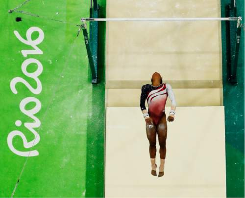 United States' Gabrielle Douglas performs on the uneven bars during the artistic gymnastics women's team final at the 2016 Summer Olympics in Rio de Janeiro, Brazil, Tuesday, Aug. 9, 2016. (AP Photo/Morry Gash)