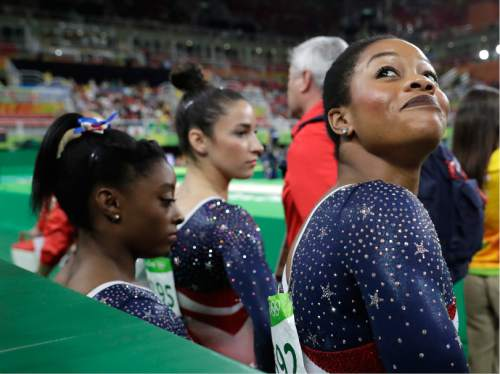 United States' Gabrielle Douglas looks back at the audience before the start of the artistic gymnastics women's team final at the 2016 Summer Olympics in Rio de Janeiro, Brazil, Tuesday, Aug. 9, 2016. (AP Photo/Charlie Riedel)