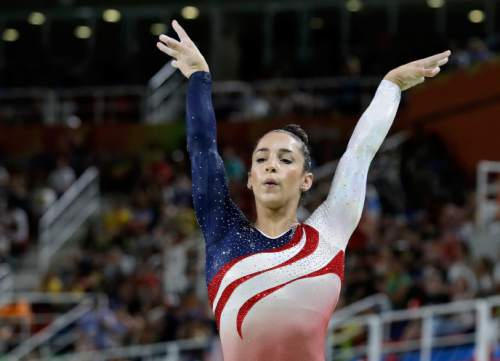United States' Aly Raisman performs on the balance beam during the artistic gymnastics women's team final at the 2016 Summer Olympics in Rio de Janeiro, Brazil, Tuesday, Aug. 9, 2016. (AP Photo/Rebecca Blackwell)