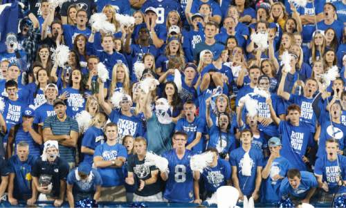 Trent Nelson     The Salt Lake Tribune BYU fans cheer on their team in the fourth quarter as the BYU Cougars host the Utah Utes, college football Saturday, September 21, 2013 at LaVell Edwards Stadium in Provo.
