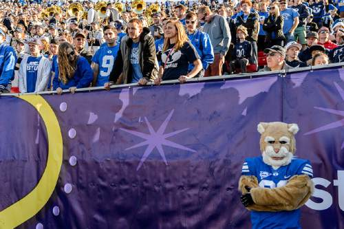 Trent Nelson     The Salt Lake Tribune BYU fans and school mascot Cosmo look on as Utah holds a 35-0 lead over BYU in the Royal Purple Las Vegas Bowl, NCAA football at Sam Boyd Stadium in Las Vegas, Saturday December 19, 2015.