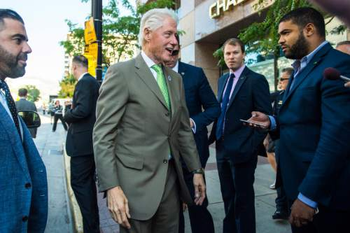 Chris Detrick  |  The Salt Lake Tribune Former President Bill Clinton greets members of the public after participating in a nonpartisan roundtable discussion at the downtown Salt Lake City offices of Kem Gardner Thursday August 11, 2016.