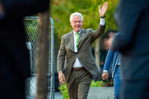 Chris Detrick  |  The Salt Lake Tribune Former President Bill Clinton waves to members of the public after participating in a nonpartisan roundtable discussion at the downtown Salt Lake City offices of Kem Gardner Thursday August 11, 2016.