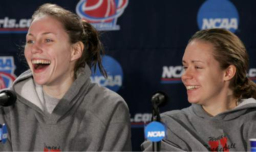 Utah's Kim Smith, left, and Shona Thorburn, right, find humor in Smith's response to a question during a news conference for their second round NCAA Tournament basketball game in Tucson, Ariz., Sunday, March 19, 2006. Utah will face Arizona State Monday. (AP Photo/Charles Rex Arbogast)