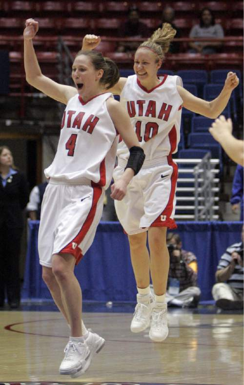 Utah's Kim Smith, left, and  Shona Thorburn celebrate their 76-71 win over Middle Tennessee after their first round NCAA Tournament basketball game in Tucson, Ariz., Saturday, March 18, 2006. (AP Photo/Khampha Bouaphanh )