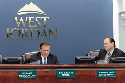 Trent Nelson  |  The Salt Lake Tribune West Jordan Mayor Kim Rolfe reads a statement regarding Councilman Jeff Haaga's recent citation during a council meeting, Wednesday August 10, 2016. Haaga was recorded July 19 on police body camera video in which he appeared to be drunk. Officers cited him for hit-and-run after witnesses said he drove away from a local bar after hitting a car in the parking lot earlier that evening. At right is Councilman Chad Nichols.