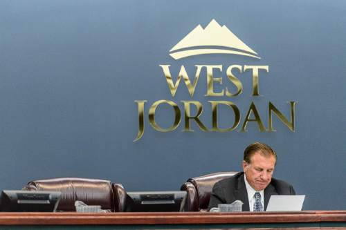 Trent Nelson  |  The Salt Lake Tribune West Jordan Mayor Kim Rolfe reads a statement regarding Councilman Jeff Haaga's recent citation during a council meeting, Wednesday August 10, 2016. Haaga was not present at the meeting, and his empty chair is at left. Haaga was recorded July 19 on police body camera video in which he appeared to be drunk. Officers cited him for hit-and-run after witnesses said he drove away from a local bar after hitting a car in the parking lot earlier that evening.