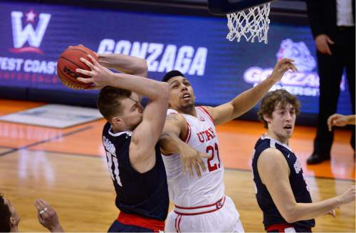 Scott Sommerdorf   |  The Salt Lake Tribune   Utah F Jordan Loveridge (21) tries to defend Gonzaga F Domantas Sabonis (11)  during first half play. Gonzaga held a 44-29 lead over Utah at the half, Saturday, March 19, 2016.