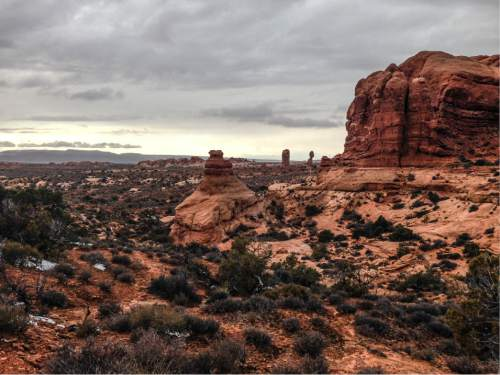 Erin Alberty  |  The Salt Lake Tribune  Rock formations stand sentry Nov. 29, 2015 near the road to Delicate Arch in Arches National Park.