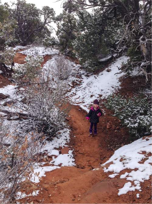 Erin Alberty  |  The Salt Lake Tribune  The author's daughter makes her way through a winter wonderland Nov. 29, 2015 at Arches National Park.