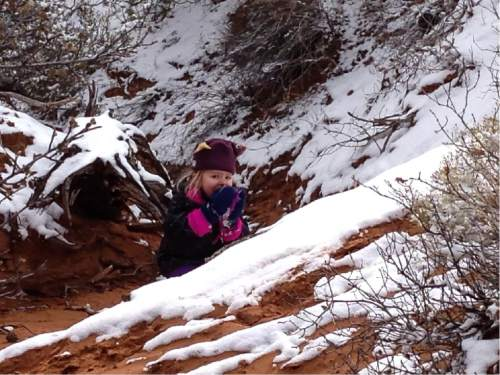Erin Alberty  |  The Salt Lake Tribune  The author's daughter gobbles up fresh snow on the Broken Arch trail Nov. 29, 2015 at Arches National Park.