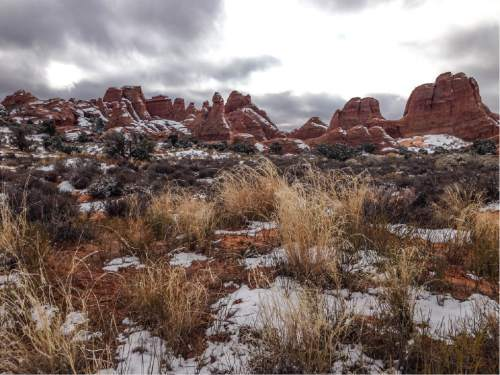 Erin Alberty  |  The Salt Lake Tribune  Sun breaks through the clouds after a snowstorm Nov. 29, 2015 near the Devils Garden campground at Arches National Park.