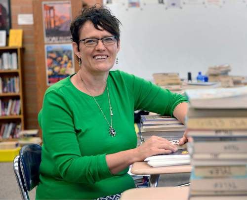 Al Hartmann  |  The Salt Lake Tribune  Denée Tyler, an Alpine School District English teacher for seventh and eighth graders at Mountain Ridge Junior High School in Highland starts to organize books in her classroom Wednesday August 10 for the new school year.  She mentors younger teachers and says that the problem isn't attracting teachers, but retaining them. Tyler believes it will take a bump in base pay to fill a shortage of teachers in the Beehive State.