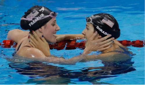 United States' Missy Franklin, left, and United States' Maya DiRado greet each other after a semifinal of the women's 200-meter backstroke during the swimming competitions at the 2016 Summer Olympics, Thursday, Aug. 11, 2016, in Rio de Janeiro, Brazil. (AP Photo/Natacha Pisarenko)