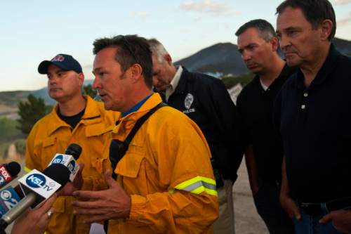 Chris Detrick  |  The Salt Lake Tribune  Unified Fire Chief Michael Jensen takes about the Rose Crest Fire near Herriman Friday June 29, 2012.