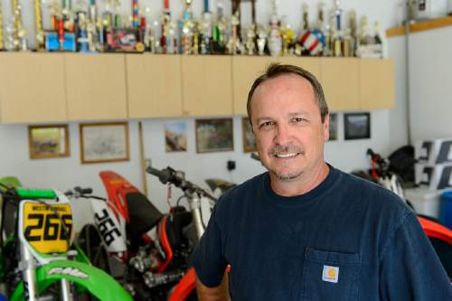 Trent Nelson  |  The Salt Lake Tribune Mel Kimball Jr. with trophies he and his son won over the course of a career in motorcycling, at his Bountiful home on Wednesday.