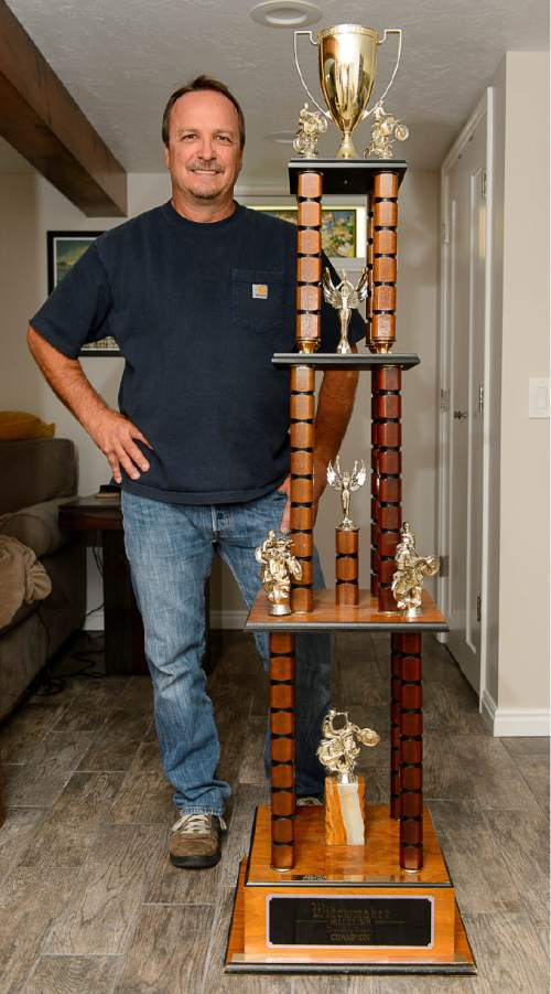 Trent Nelson  |  The Salt Lake Tribune Mel Kimball Jr. with the traveling trophy from The Widowmaker Hill Climb, an annual event in Draper than ran in the 60s, 70s and 80s. Thousands of spectators watched motorcyclists try to make their way up one of the toughest hills in the world. Only a handful of people ever make it over the top. One of those people was, who made it over in 1986 and 1988 -- the last year of the race, before it was shut down because of the rambunctious crowds and safety issues. Kimball still has the bike he used to ride in those races and the traveling trophy that was passed on to the newest champions. Bountiful, Wednesday August 3, 2016.