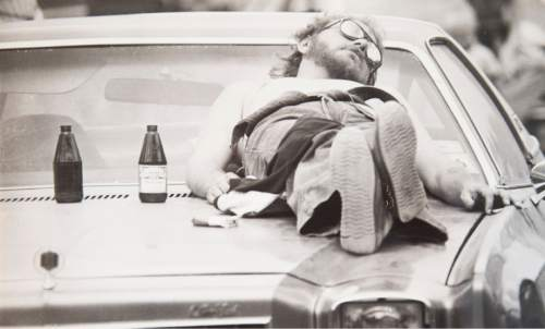 Tribune file photo  A man sleeps on the hood of his car during a Widow Maker event in 1982.