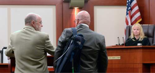 """Al Hartmann     The Salt Lake Tribune Defense lawyer Ron Yegich, left, stands with his client Timothy Lawson,  dubbed a """"fixer"""" for former Utah Attorney General Mark Shurtleff in Judge Katie Bernards-Goodman's courtroom in Salt Lake City Monday April 25.  Lawson is charged with six felonies -- including counts of tax evasion, witness tampering, obstruction of justice and a pattern of unlawful conduct -- stemming from allegations that he attempted to intimidate or threaten individuals with ties to Shurtleff and his successor, John Swallow."""